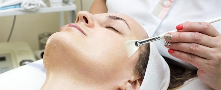 woman having chemical peel treatment