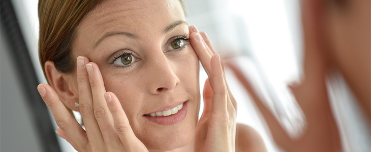 woman moisturising skin